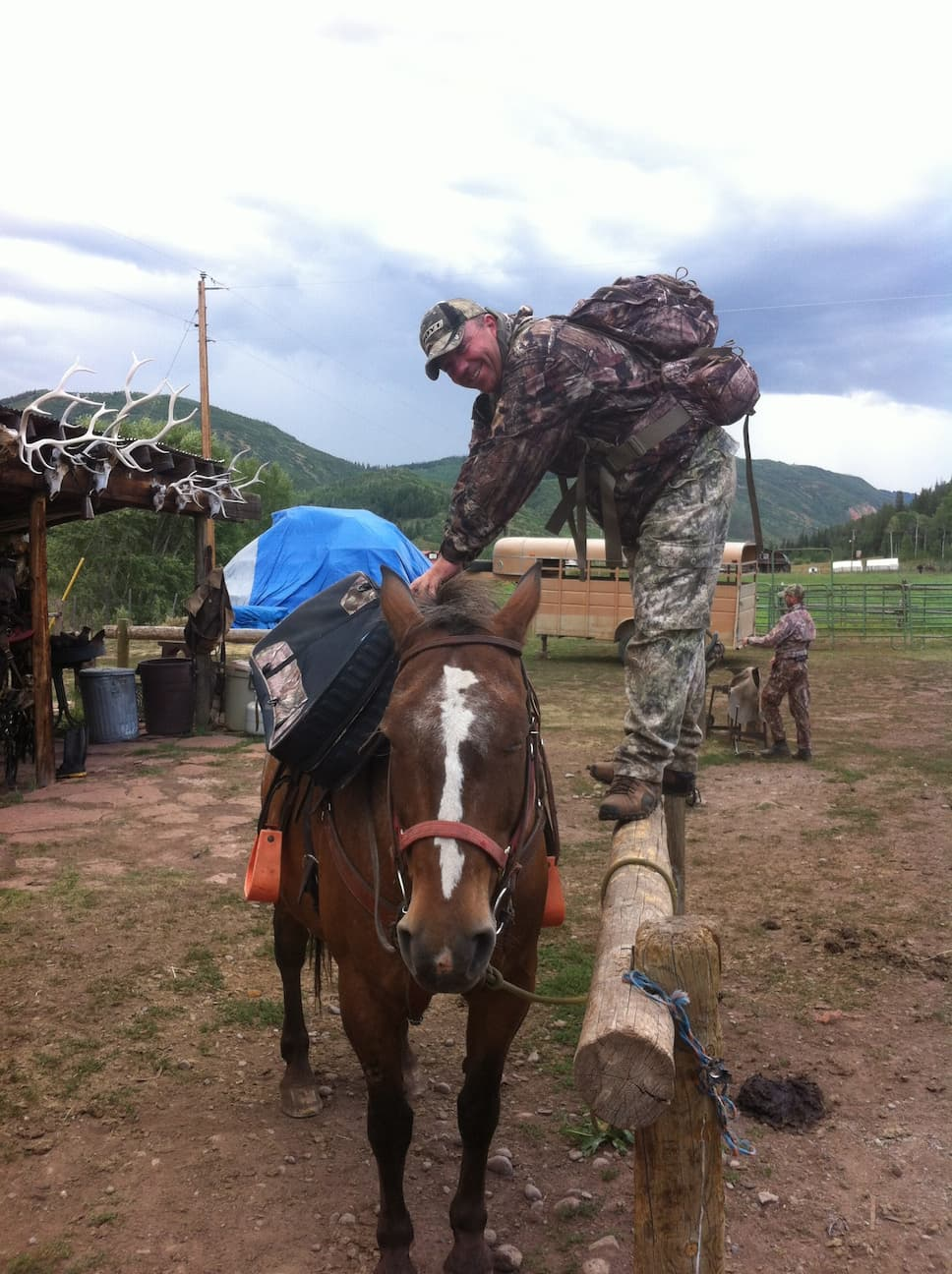 Hunting Guide mounting horse