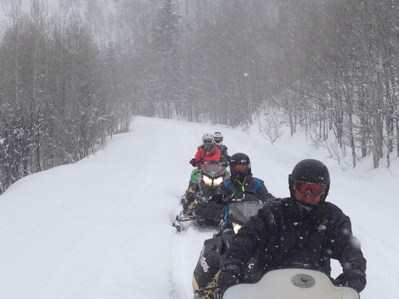 snowmobiling on snowy day